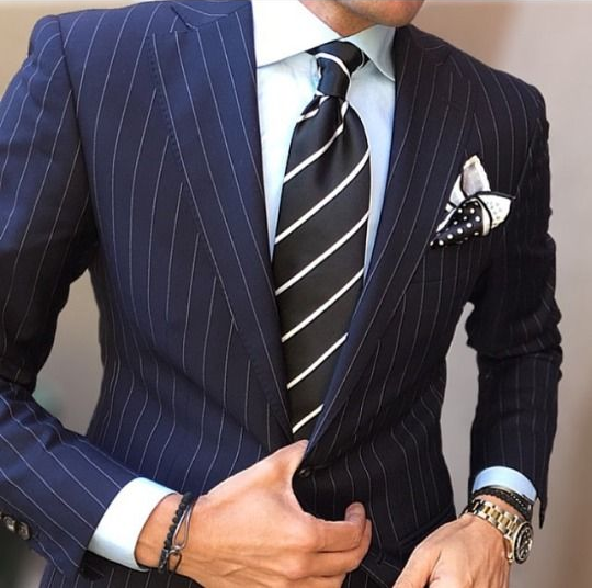Man in suit and striped tie.