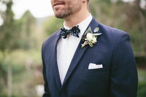 pocket square accenting coat and tie
