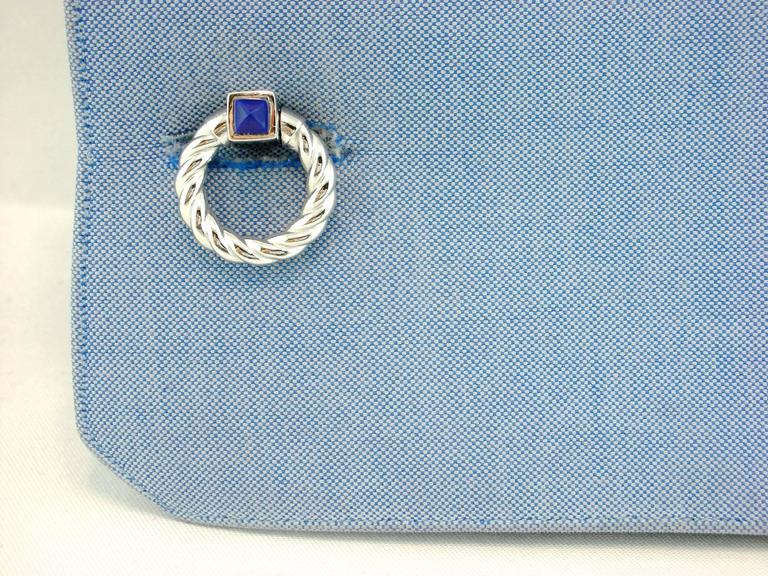 Jona design collection hand crafted in Italy rhodium plated sterling silver double ring folding cufflinks with Lapis cabochons. Marked JONA 925. These links push through the shirt cuff and fold down either side to keep them locked in tightly.