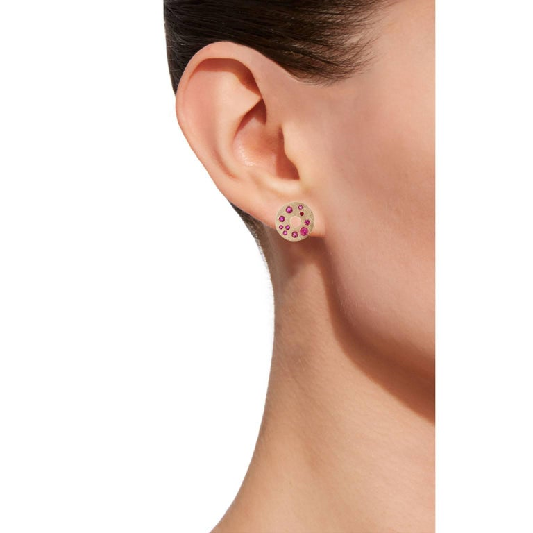Jona design collection hand crafted in Italy 18 karat brushed rose gold stud earrings set with 0.71 carats of round cut  rubies. Diameter 0.63 inch. All Jona jewelry is new and has never been previously owned or worn. Each item will arrive at your