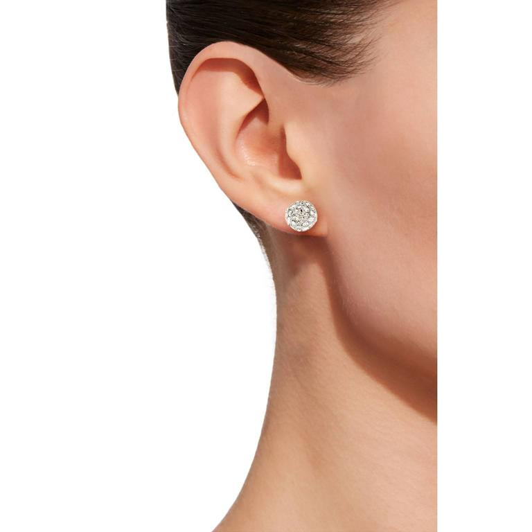 Jona design collection hand crafted in Italy 18 karat white gold diamond pavé ear studs set with 1.04 carats of white diamonds F color VVS1 clarity. Dimensions: Diameter 0.32 in - 8mm All Jona jewelry is new and has never been previously owned