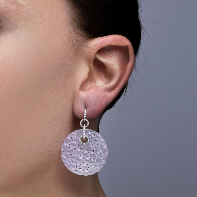 Jona design collection hand crafted in Italy One-of-a-Kind 18 karat white gold pendant earrings set with 106 white diamonds weighing 042 carats suspending two carved Lavender Jade discs weighing 55.5 carats. Dimensions: H 1.63 in x Dm 1.27 in x