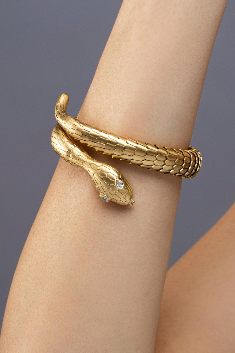 Jona design collection hand crafted in Italy 18 karat brushed yellow gold flexible coil snake bracelet. Two drop cut diamonds weighting 0.19 carats set on the head of the serpent. The body made of flexible scaled brushed gold links. Dimensions: H