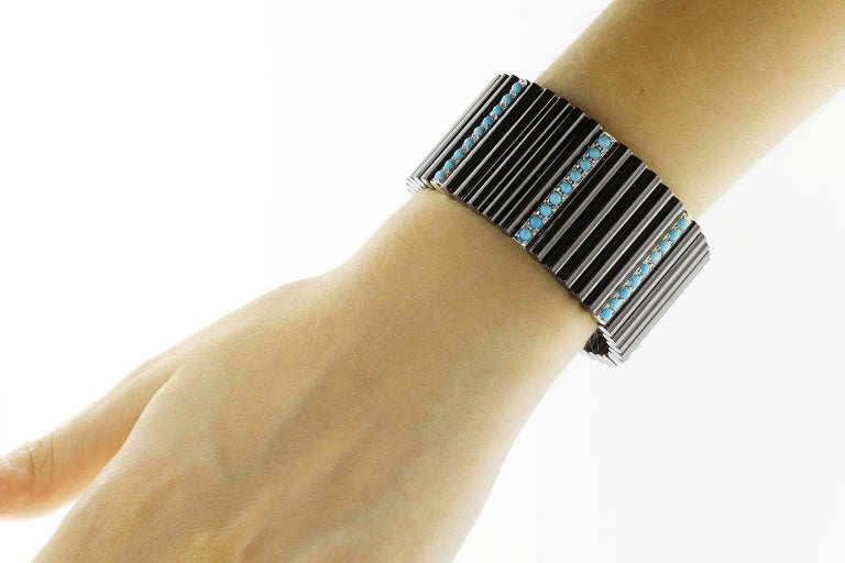 Jona design colletin hand crafted in Italy high-tech dark grey ceramic cuff flexible bangle 3cm wide alternating 18 karat white gold elements set with turquoise cabochons.  All Jona jewelry is new and has never been previously owned or worn.