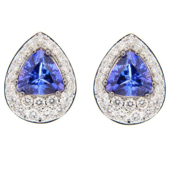 Jona design collection hand crafted in Italy 18 karat white and yellow gold stud earrings set with two triangle cut Tanzanite weighing 1.35 carats surrounded by 44 brilliant cut white diamonds F color VVS1 clarity weighing 0.48