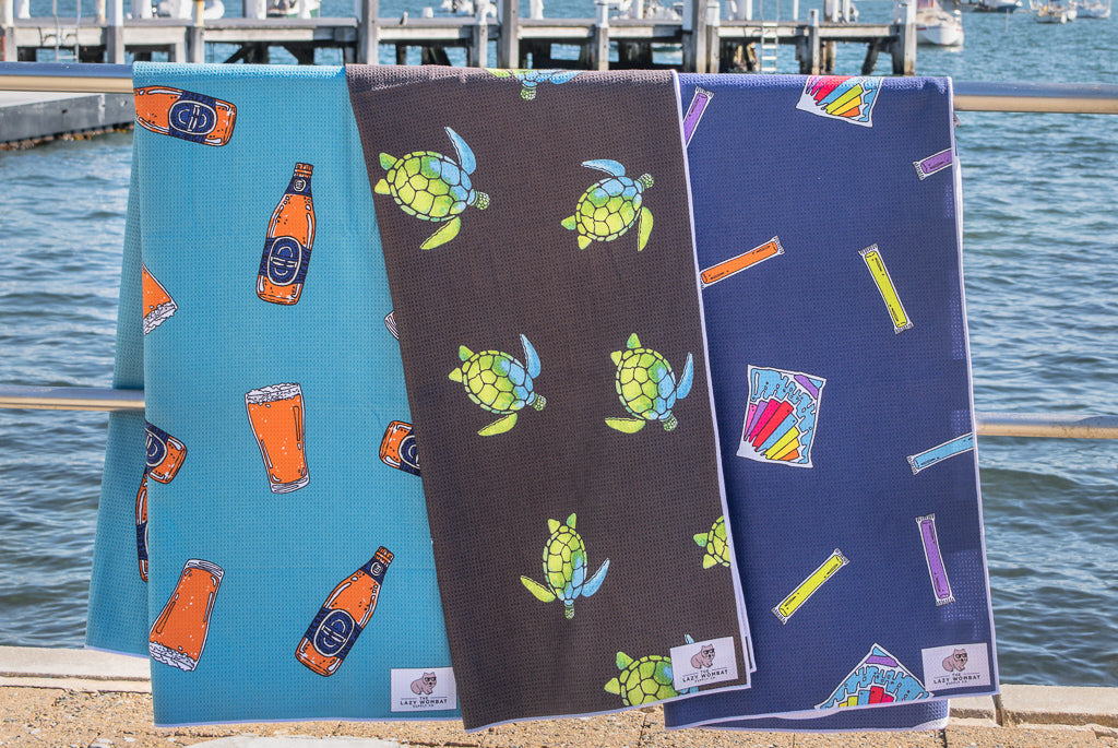 Three Lazy Wombat sand free beach towels hanging in Watson's bay, beer, turtles and ice blocks