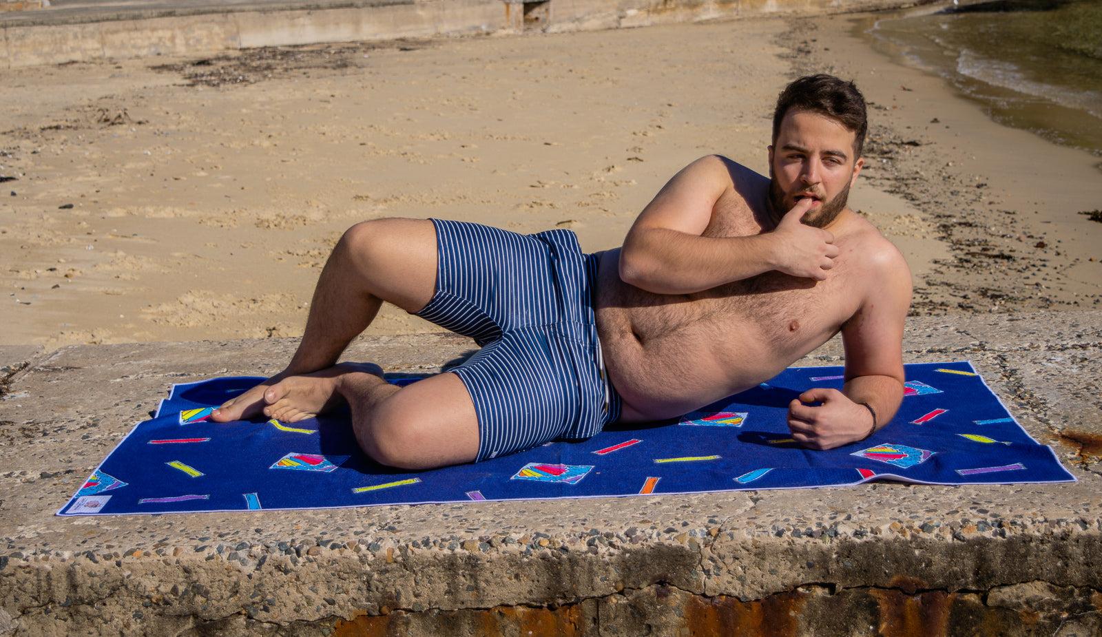 Funny pose on Lazy Wombat sand free ice block beach towel in Watson's bay