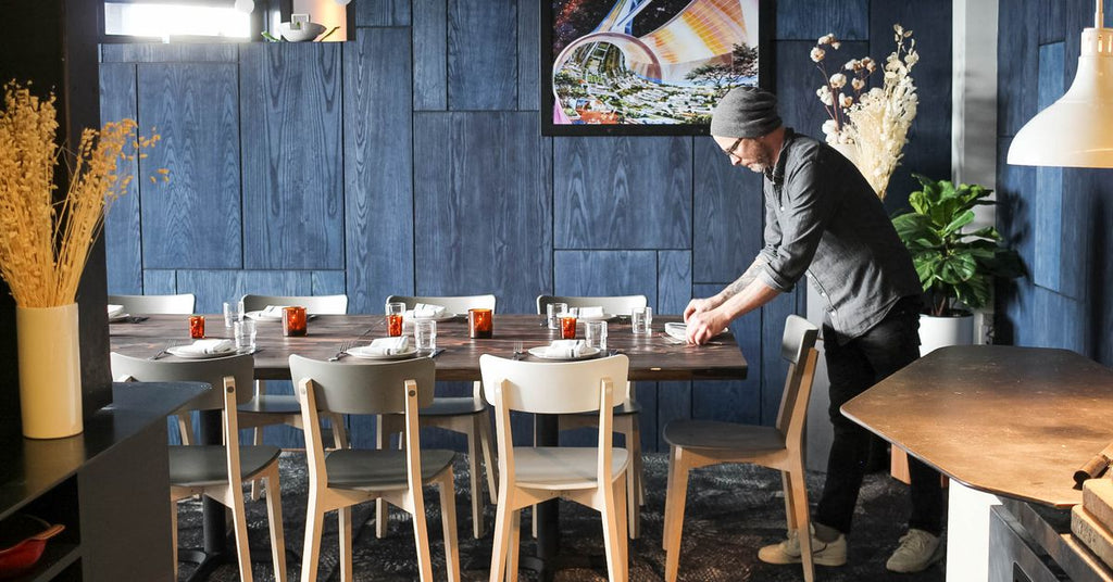 Chef Anthony Strong prepares a table at his San Francisco restaurant, Prairie