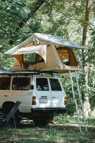 A roof top tent on a white SUV