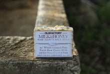 Load image into Gallery viewer, the healthy promise soap handcrafted all natural goats milk and honey front view on a stone wall
