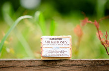 Load image into Gallery viewer, the healthy promise soap handcrafted all natural goats milk and honey front view on a wooden fence
