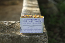 Load image into Gallery viewer, the healthy promise soap handcrafted goats milk field and flower front on stone wall