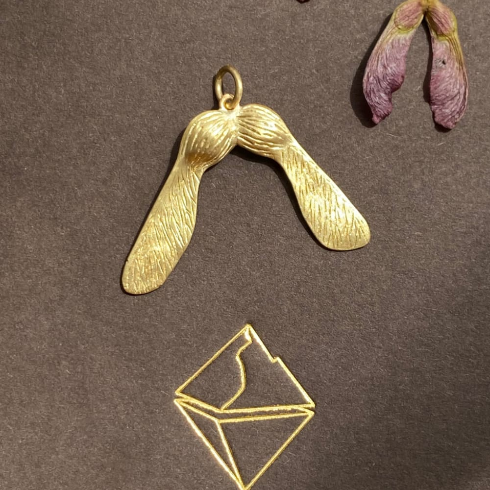 Designed as an 18K gold maple key. The sugar maple is a sacred tree for the people of the First Nations. Read more about this MAGIC tree in Robin Wall Kimmerer's Braiding Sweetgrass: Indigenous Wisdom, Scientific Knowledge and the Teachings of Plants.  This pendant is entirely handmade here in NYC an will ship in 1 week.
