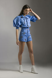 BLUE SHORTS WITH FLORAL EMBELLISHMENT - MellowDrama
