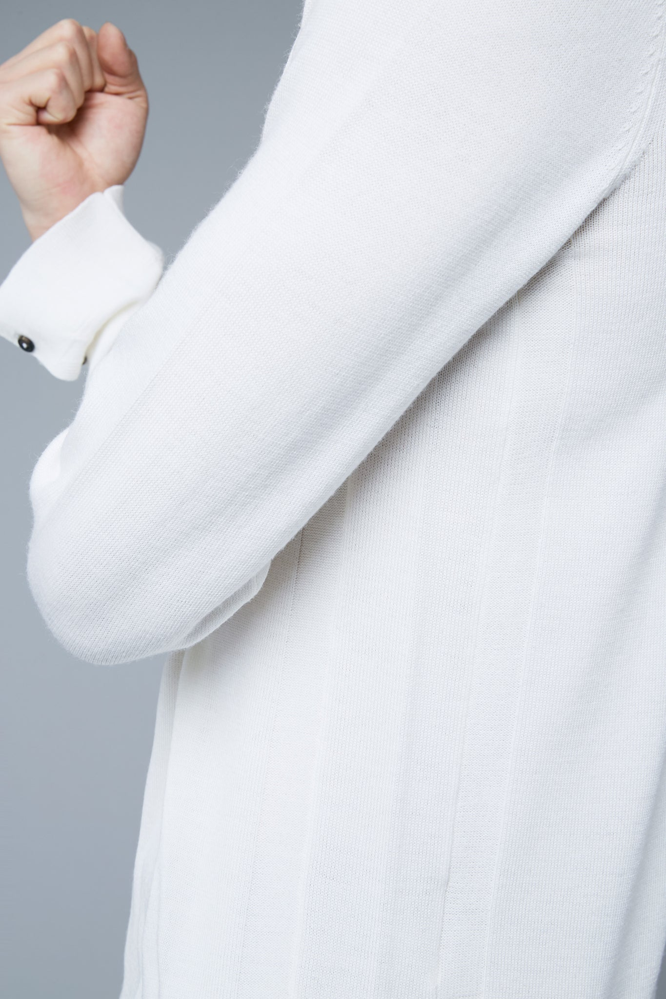Detail View: Model Qiang Li wearing Long Sleeve Sweater Tee