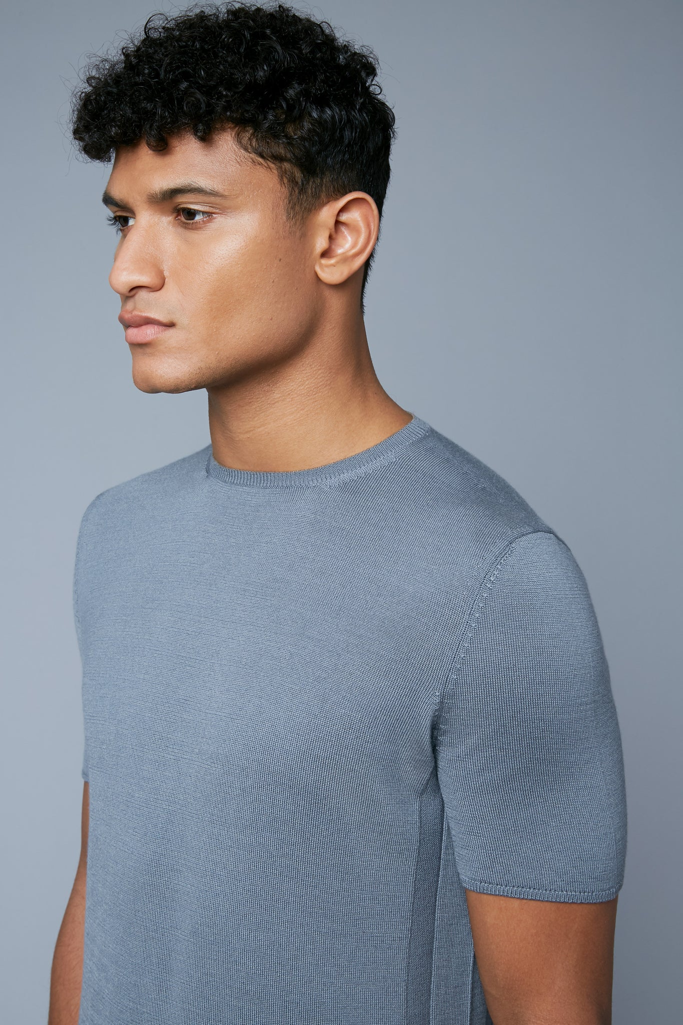 Mood View: Model Tre Boutilier wearing Short Sleeve Sweater Tee