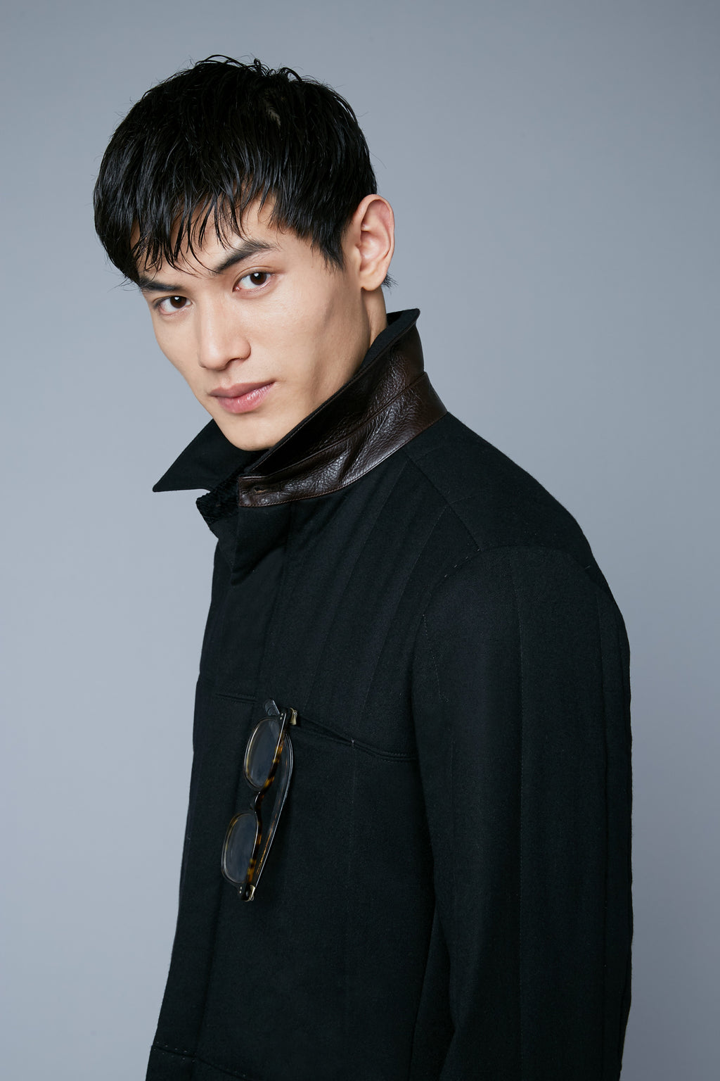 Detail View: Model Qiang Li wearing Down Téchin Jacket
