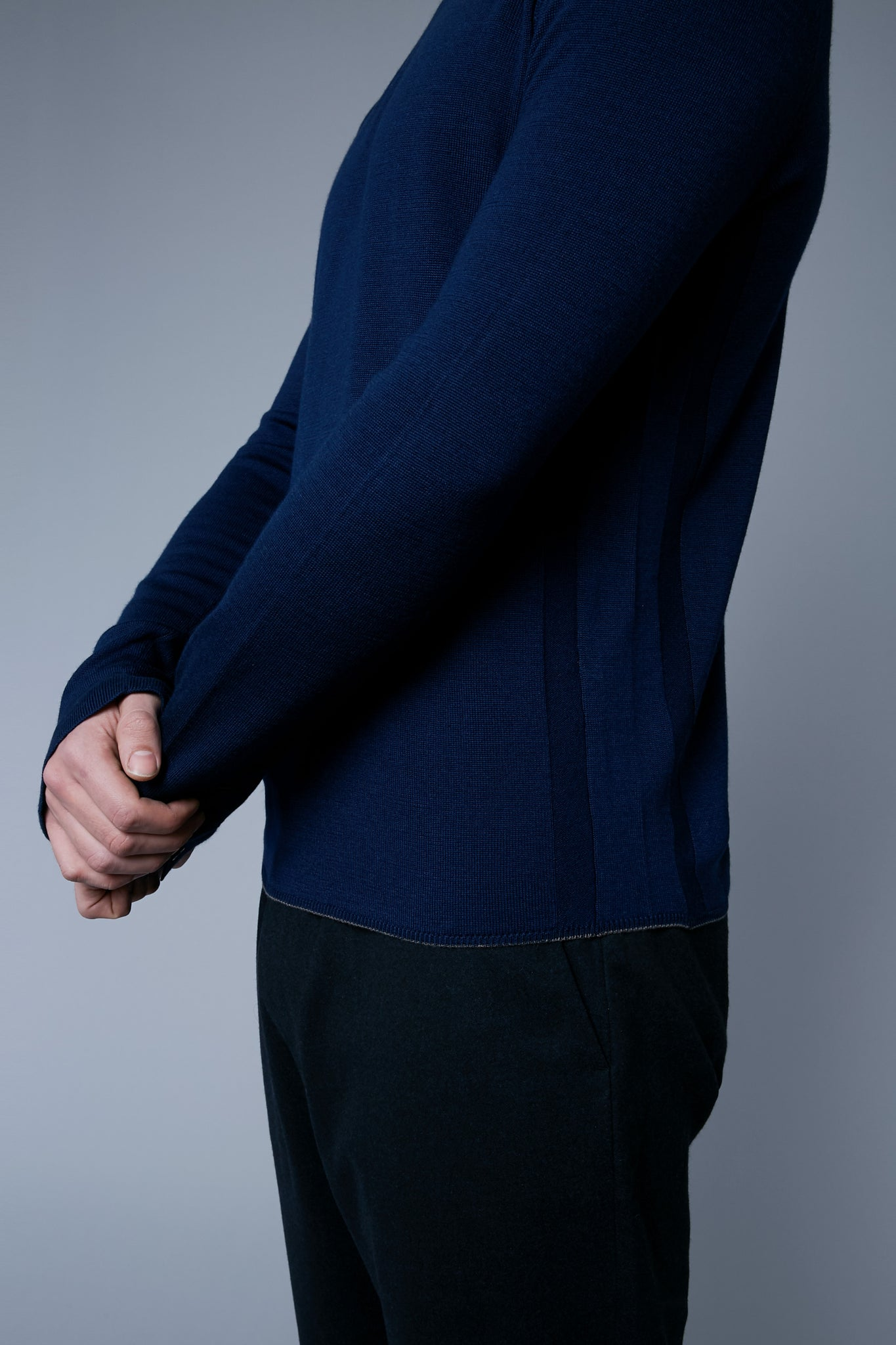 Detail View: Model Milos Drago wearing Long Sleeve Sweater Tee