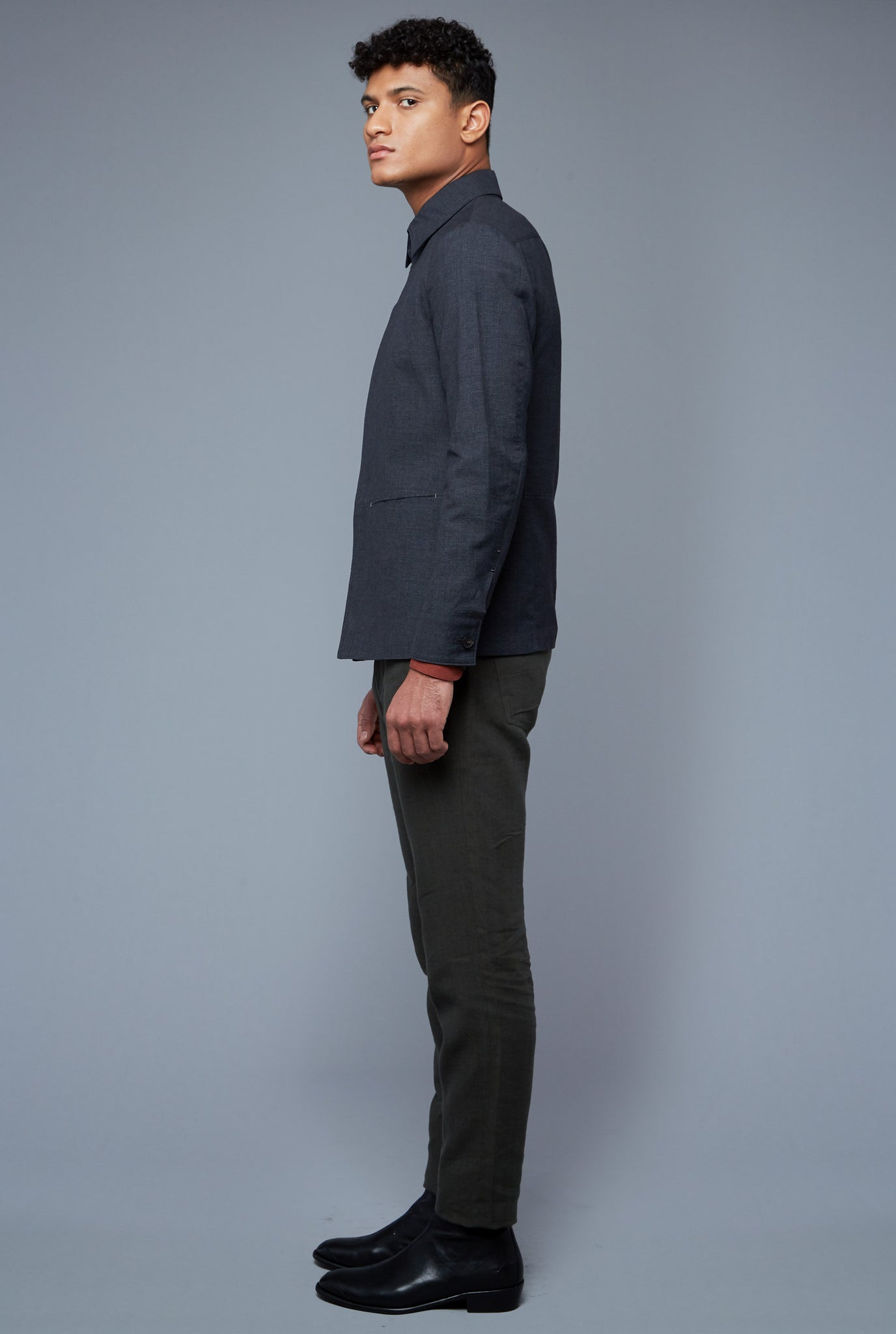 Side View: Model Tre Boutilier wearing Half Lined Téchin Jacket