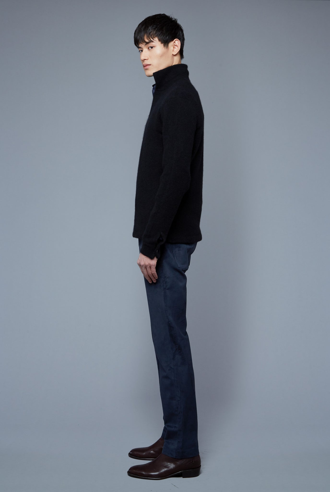 Side View: Model Qiang Li wearing Cashmere Boucle Sweater