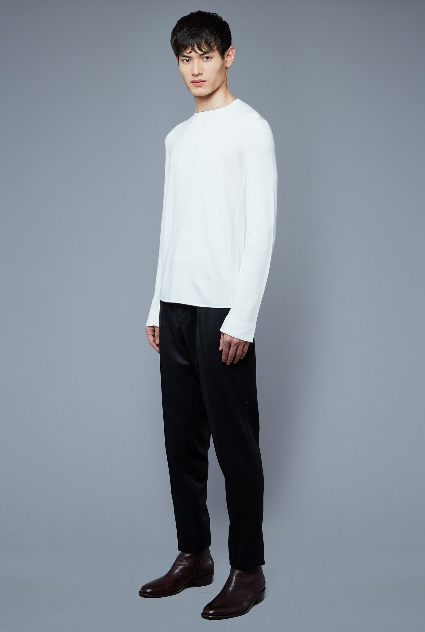 Three Quarter View: Model Qiang Li wearing Long Sleeve Sweater Tee