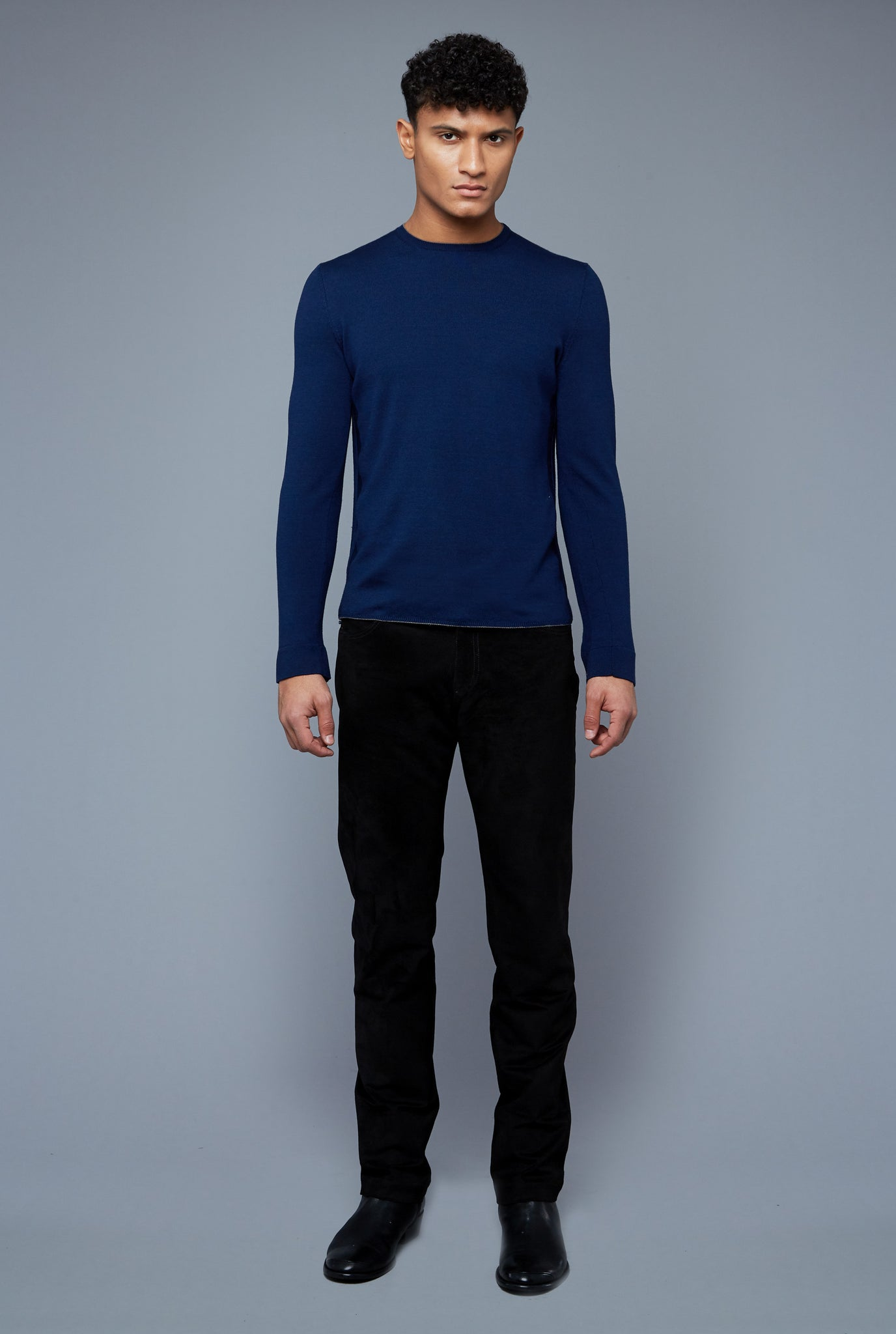 Front View: Model Tre Boutilier wearing Long Sleeve Sweater Tee