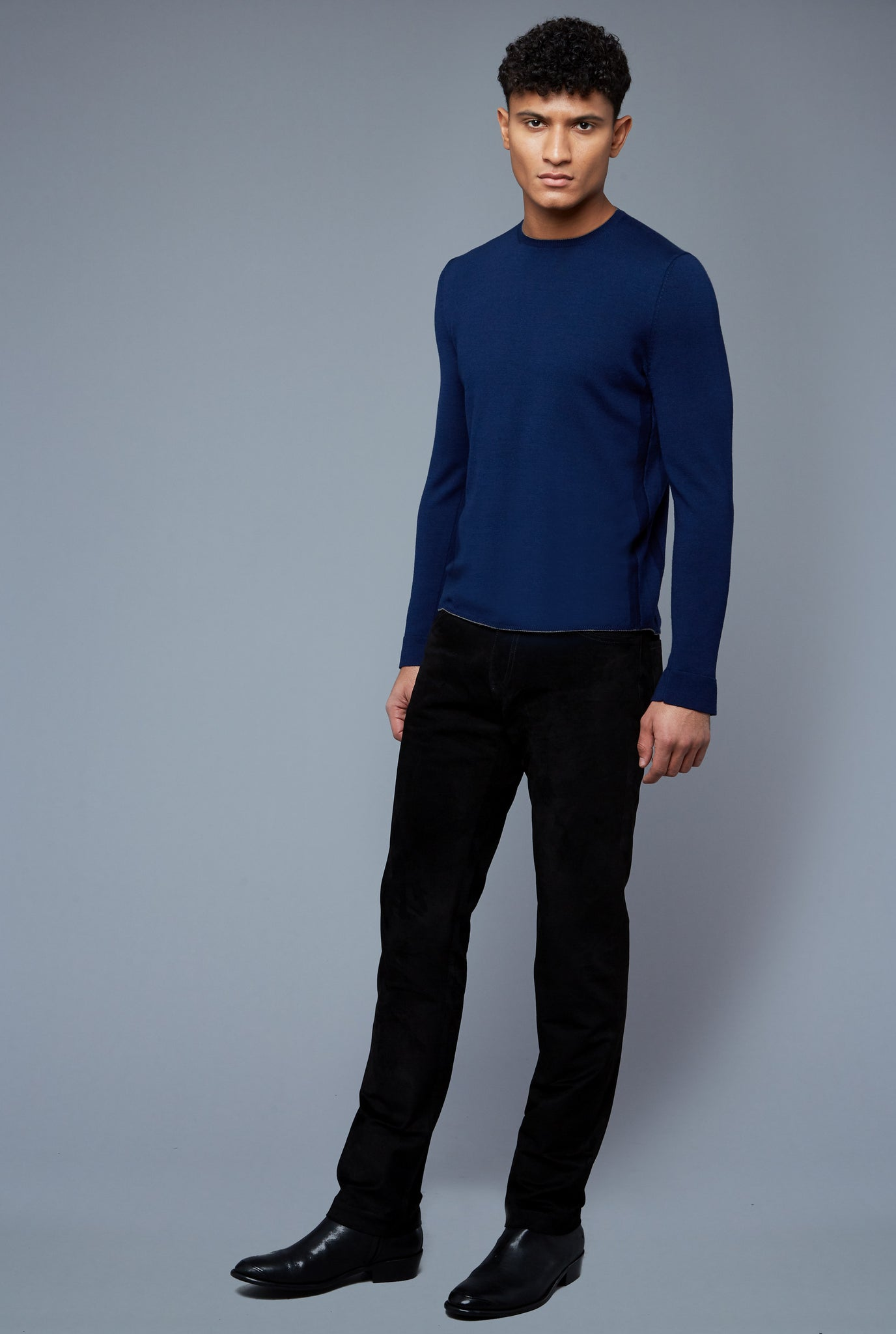 Three Quarter View: Model Tre Boutilier wearing Long Sleeve Sweater Tee