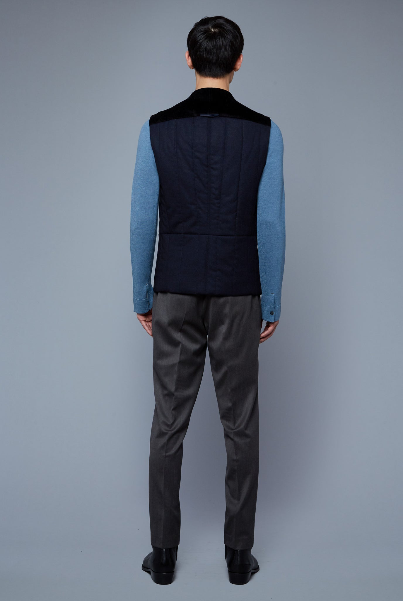 Back View: Model Qiang Li wearing Down Vest