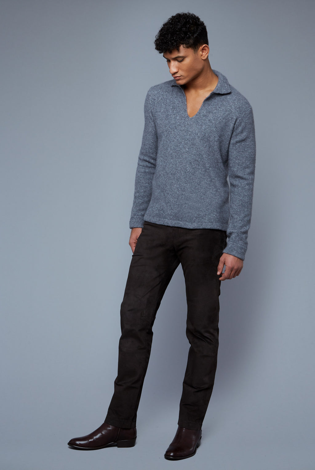 Three Quarter View: Model Tre Boutilier wearing Cashmere Boucle Sweater