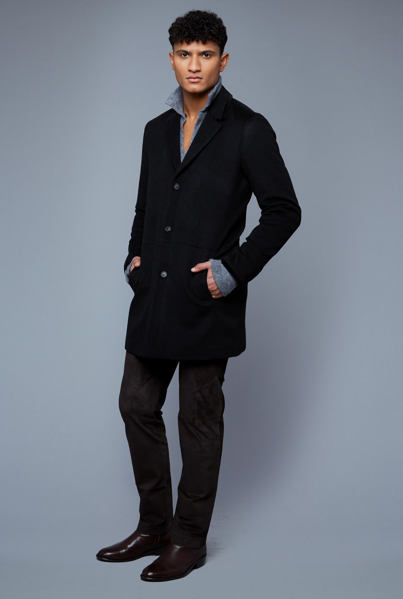 Three Quarter View: Model Tre Boutilier wearing Camel Coat