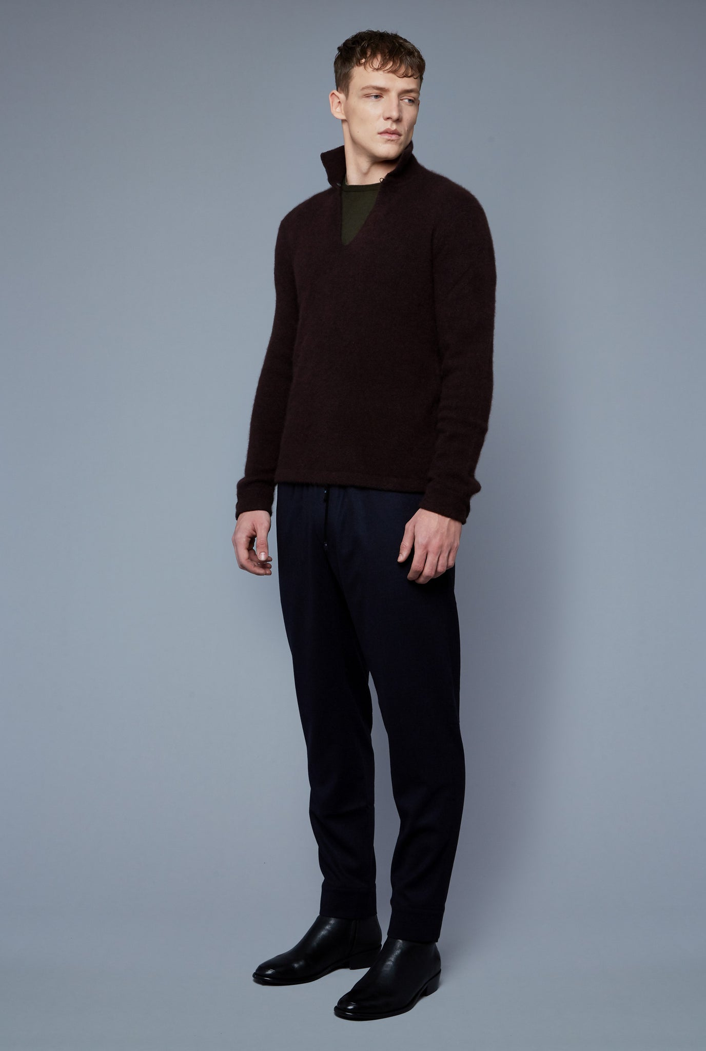 Three Quarter View: Model Milos Drago wearing Cashmere Boucle Sweater