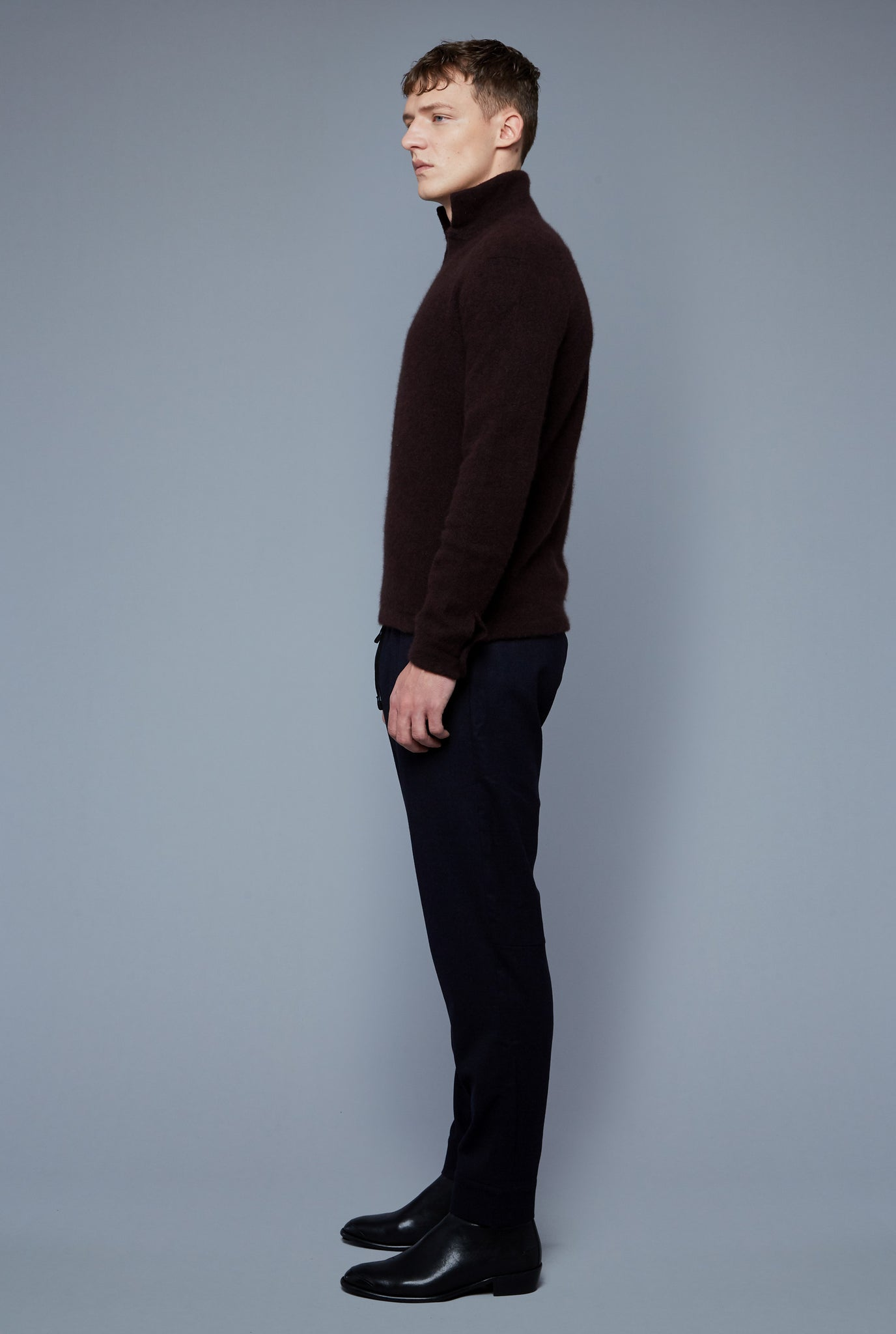 Side View: Model Milos Drago wearing Cashmere Boucle Sweater