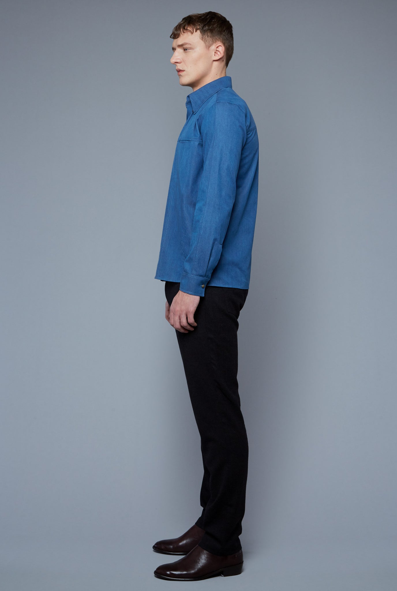 Side View: Model Milos Drago wearing Kojima Denim Shirt