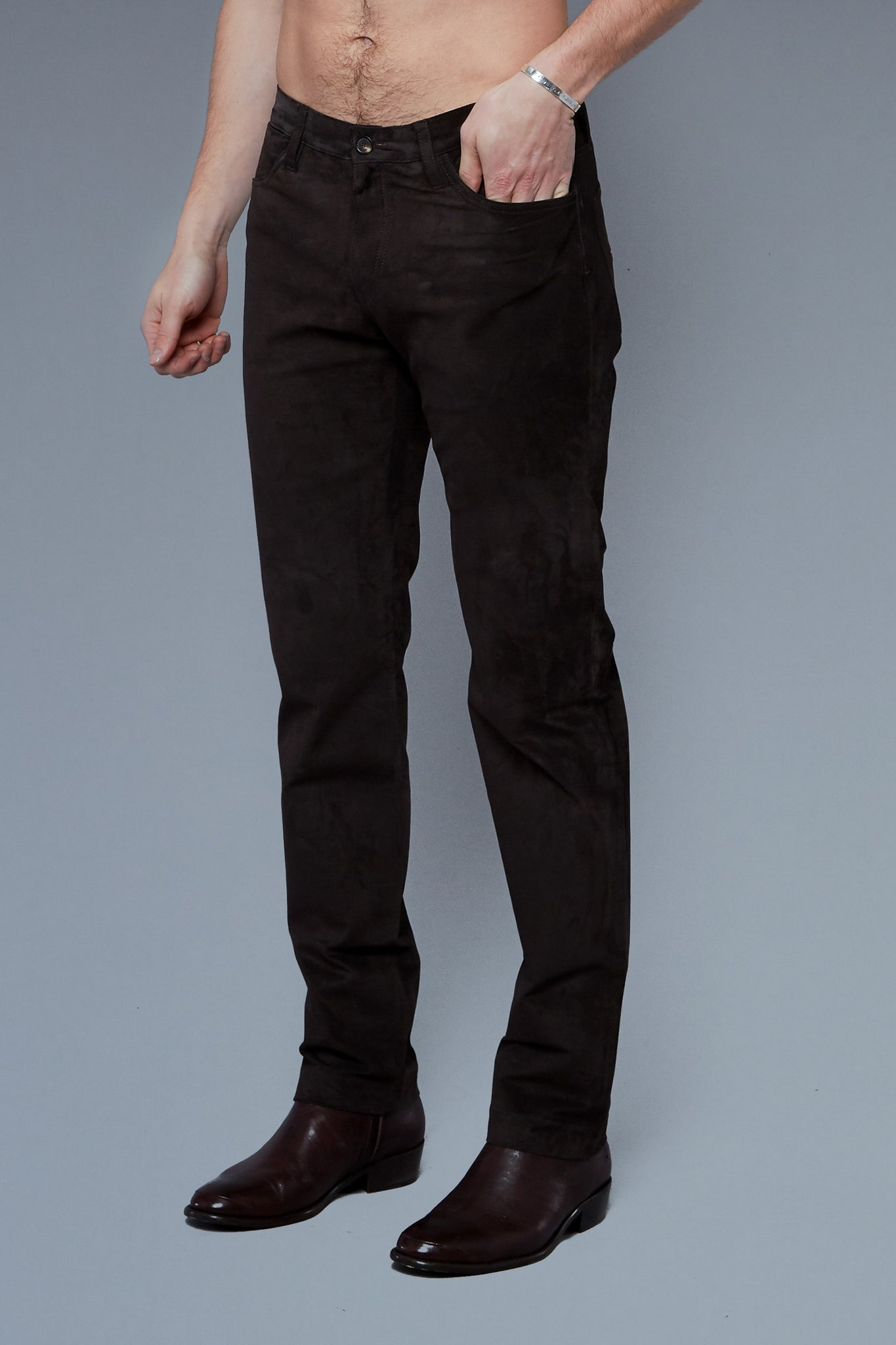 Three Quarter View: Model Hans Weiner wearing Suede 5 Pocket Pants
