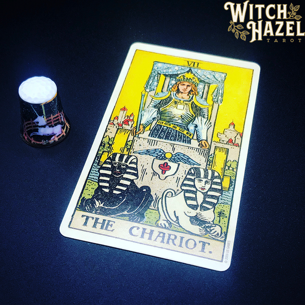 The Chariot tarot card from the Rider-Waite deck, pictured with a Unicorn of Scotland thimble on a navy background. A detailed card image description is in the body text of this article.