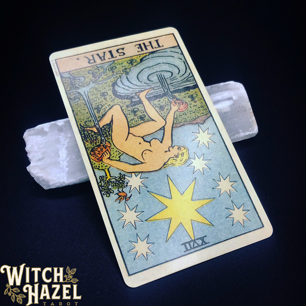 The Star tarot card pictured with a thick selenite crystal wand. Detailed image description in body text.