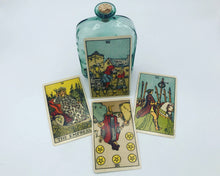 Load image into Gallery viewer, Best friends tarot spread featuring four Rider-Waite-Smith tarot cards and a witchy bottle of magic moon water
