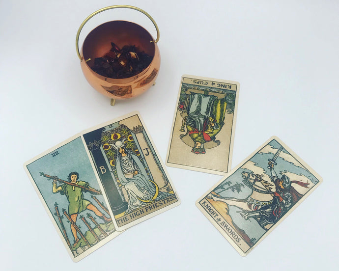 A preview of the Breakup Closure tarot spread with four cards and a copper cauldron