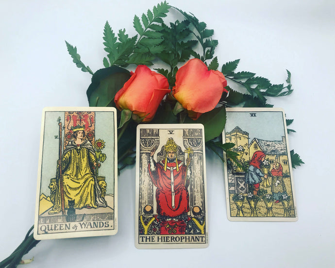 New relationship love tarot spread. A preview of this online tarot reading with three cards and fresh roses.