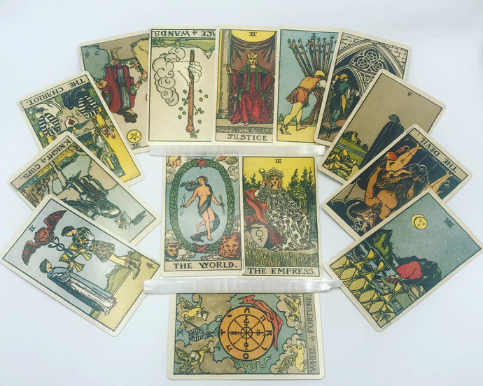 Tarot horoscope spread preview featuring 14 Rider-Waite-Smith tarot cards and two crystals