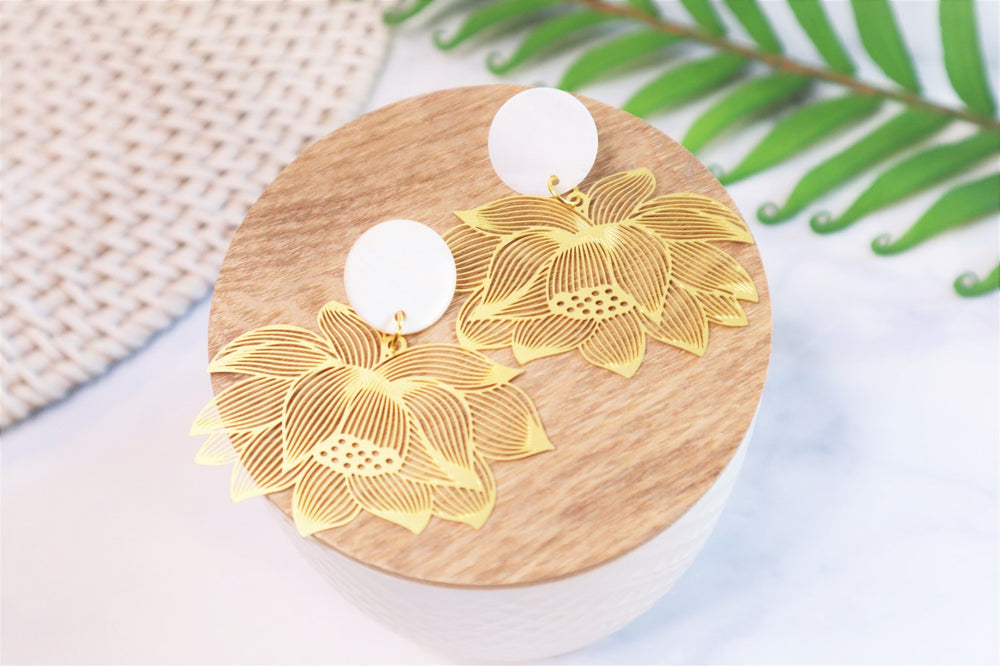 Golden flower statement earrings
