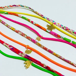 Liberty charm bracelet - Liberty of London with neon elastic