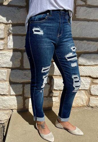 Jake High Rise Distressed Patched Up Skinny Jeans