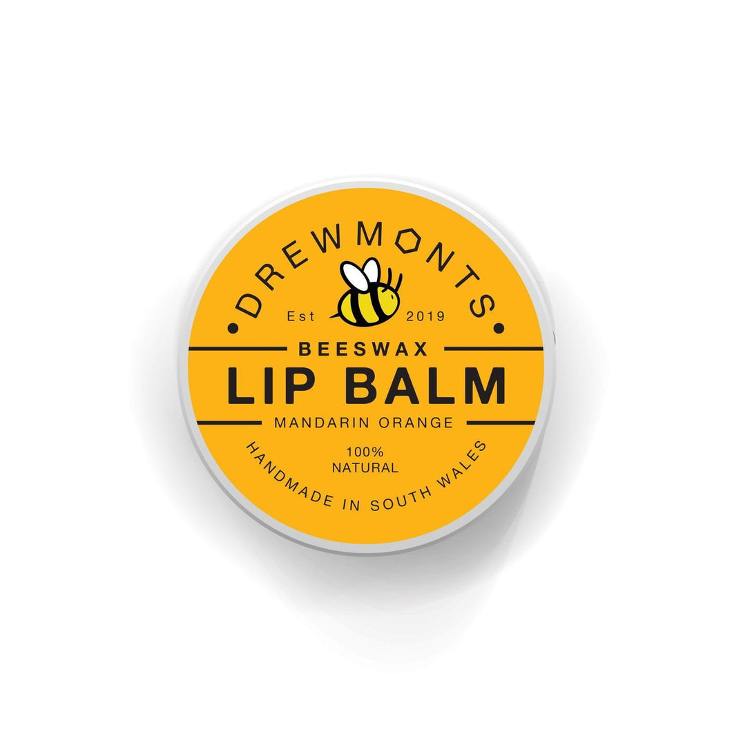Mandarin orange beeswax tin of lip balm with branding on the top