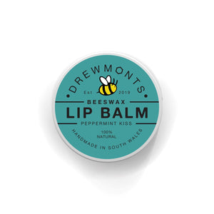 Deep minty green top of the beeswax peppermint lip balm