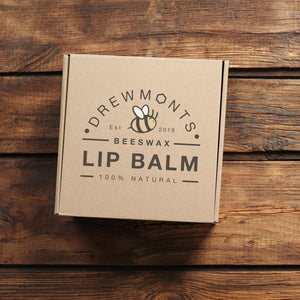 Light brown handmade recycled packaging that wraps the beeswax lip balm