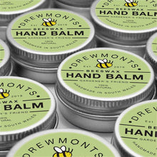 Load image into Gallery viewer, Lots of beeswax hand balm tins next to each other