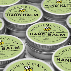 Lots of beeswax hand balm tins next to each other