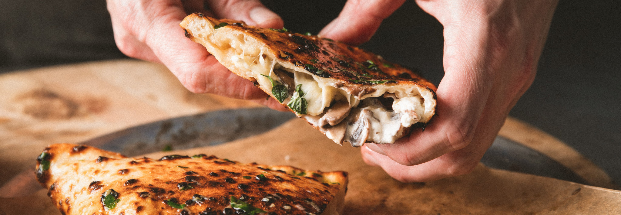 Mushroom and ricotta calzone with garlic butter