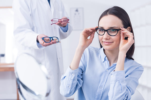 optician-with-eyeglasses-and-client